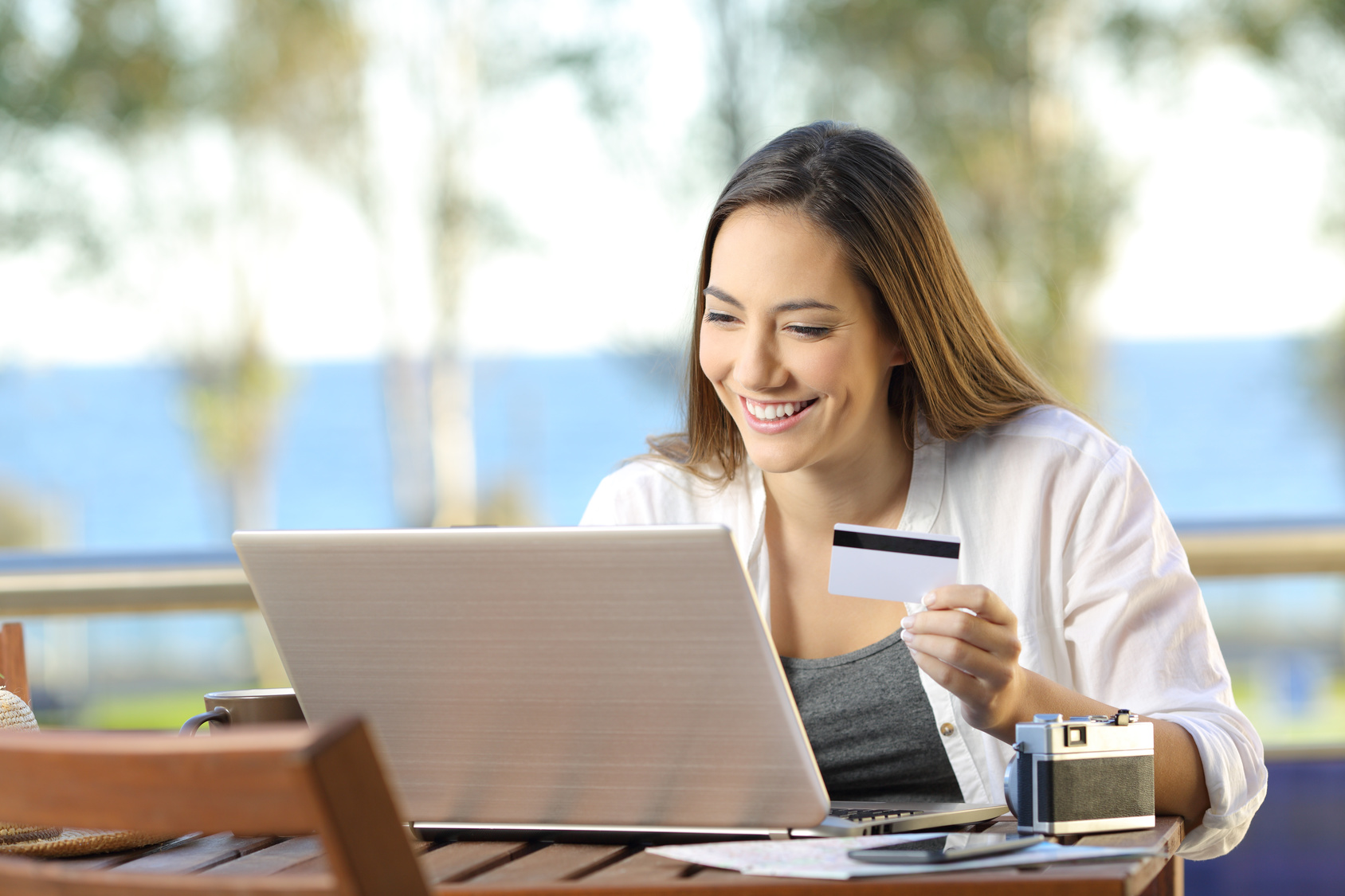 Tourist paying online with a credit card at hotel